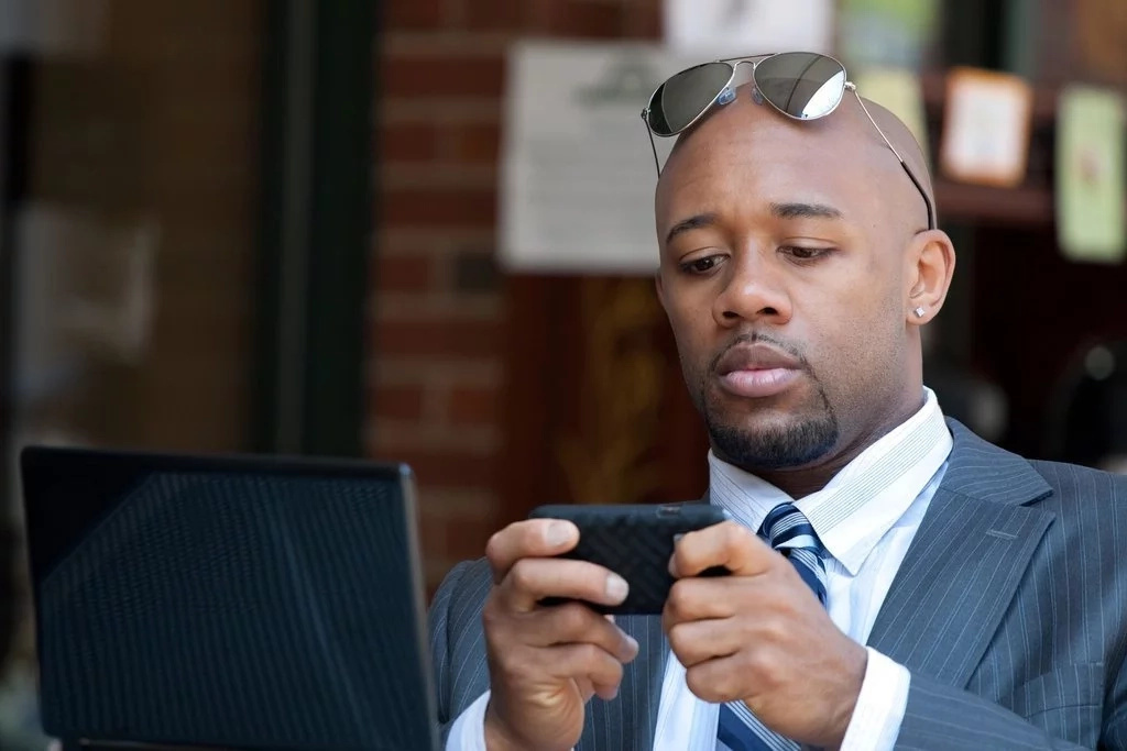 Black man with a cell phone