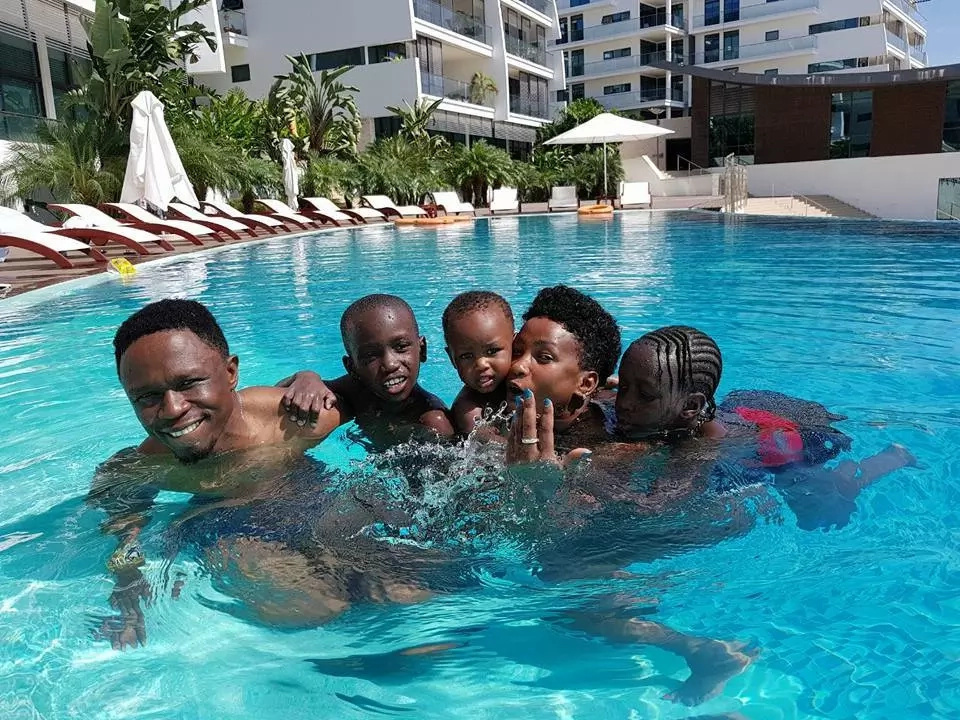 Eye-catching photos of Ababu Namwamba, wife and kids playing in a swimming pool in Mombasa