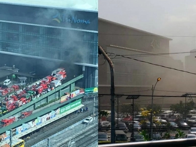 Mall goers shocked as fire raised to 2nd alarm hits Trinoma Mall in QC