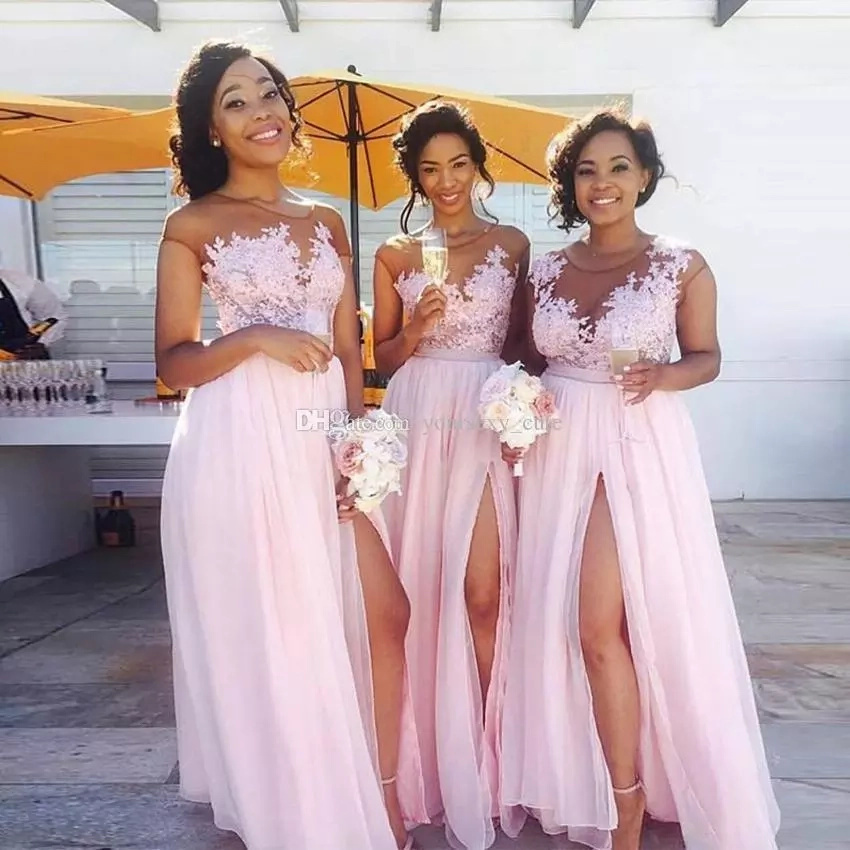 Beautiful bridesmaids in flowing, pink, chiffon dress