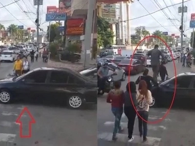 Pedestrians carelessly walk over this car because of what its driver did on the road!
