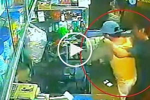 Heroic Pinoy customer in grocery store fights deadly hold-upper in Caloocan to save cashier