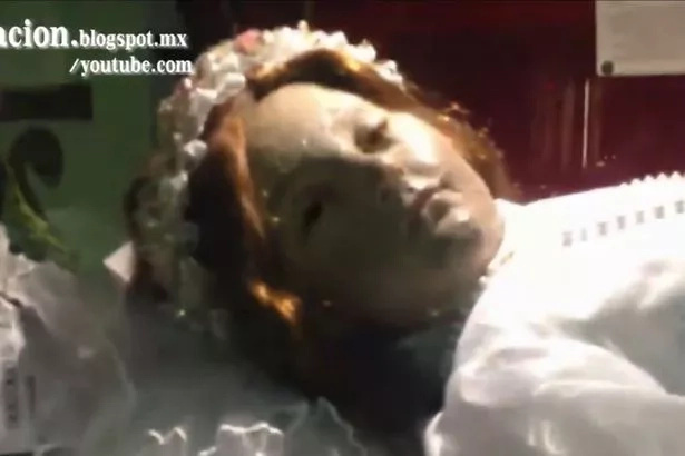 A 300 year old body of a child saint opens her eyes in this video