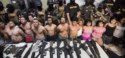 See 13 male and 5 female members of brutal gang that rules world's most VIOLENT city (photos)