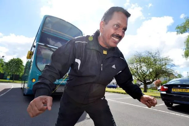Grandad breaks own world record, pulls giant bus with ponytail