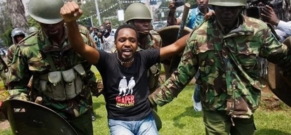 Boniface Mwangi Sues Police For Denying Him Access To State House On Anti-Graft March