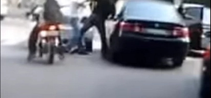 Infuriated taxi driver battles a couple caught in a road rage video