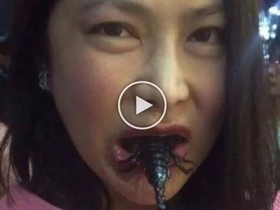PH Undersecretary Karen Jimeno munch grilled scorpion during China visit