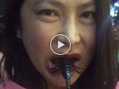 PH's DPWH undersecretary Karen Jimeno gamely munch gross scorpions during China visit