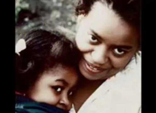 Michelle snuggling close to her mother Marian