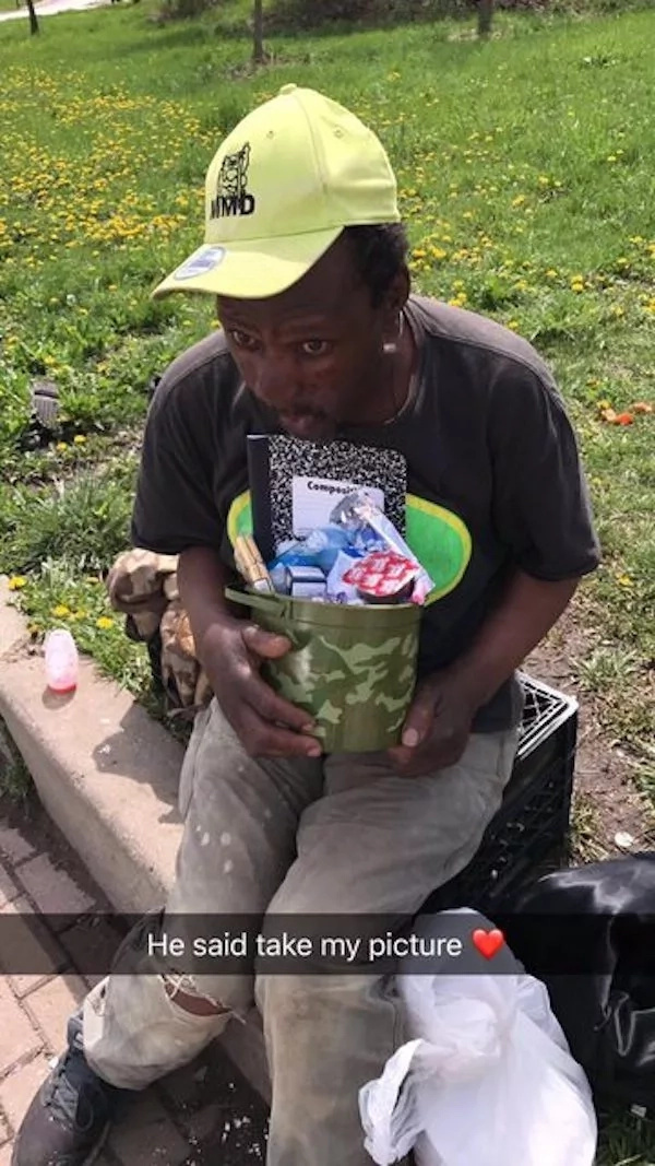 One of the homeless people with his blessings basket