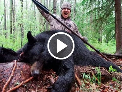 Outrageous footage of hunter spearing black bear to death in order to eat it!