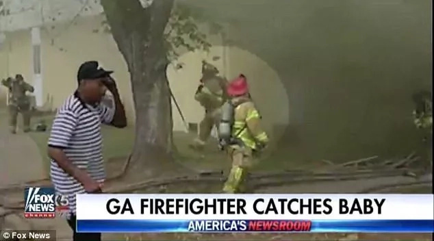 Hero firefighter catches baby thrown from second floor of burning building