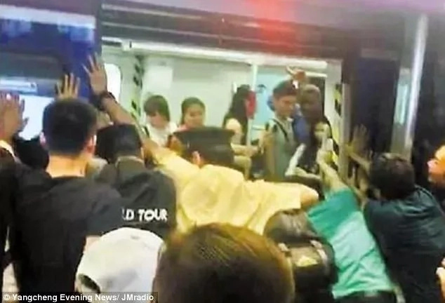 Tense moment as commuters join forces to save woman, 72, trapped between train and a platform (photos)