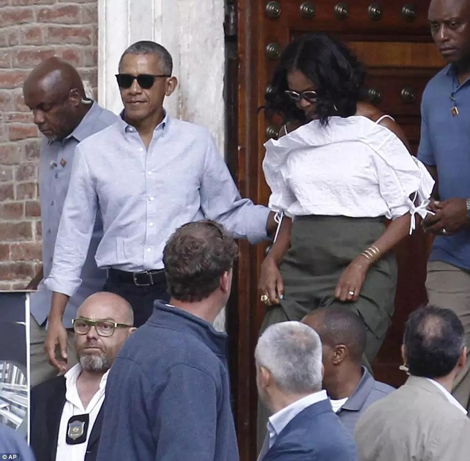 Barack and Michelle Obama seen embarking on a walkabout of Siena in Tuscany