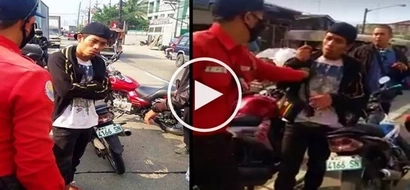 Netizens slam alleged motorcycle thief for acting arrogantly toward traffic enforcers in Valenzuela City