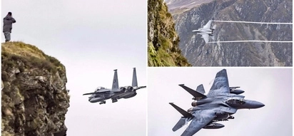 Awesome sight! Lucky photographers snap US fighter jet flying below them just 60 meters away