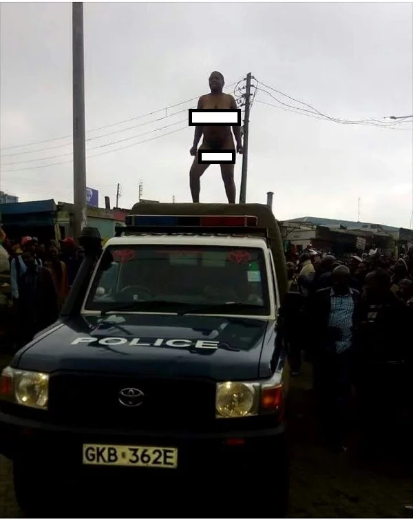 Kenyan woman strips naked, dances on top of a police vehicle (photos)