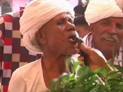 Indian Man Makes Cobras Bite His Tongue To Get High