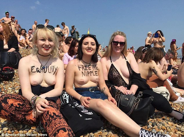 Topless men and women protest to stop sexual objectification