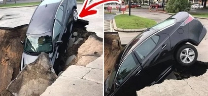 Elderly couple were having a regular day on the road. A sinkhole suddenly appears beneath them which sent them scrambling for dear life!