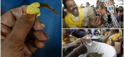 Bizarre! 5,000 people line up to swallow LIVE fish covered in paste believed to cure asthma (photos)