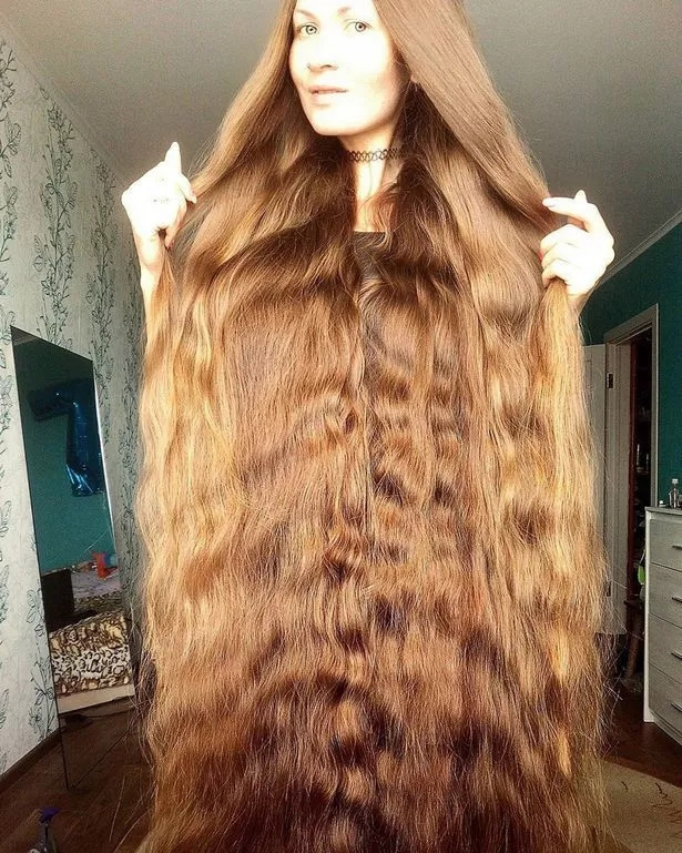 Meet girl with golden 1.5 metres long hair who hasn't cut her locks for 14 years, wants them to reach toes