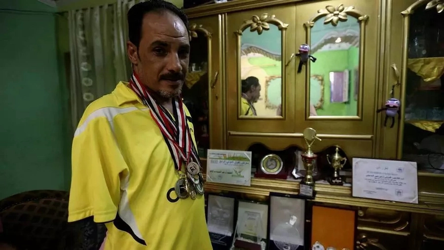 Ibrahim pictured with some of his medals. Photo: Reuters