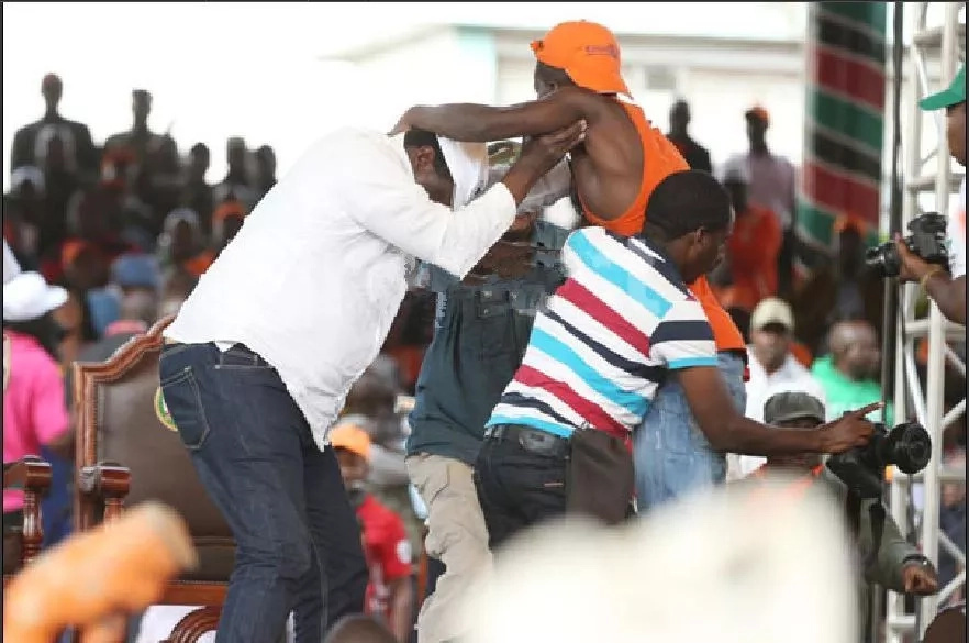 Man jumps on stage and forces Musalia Mudavadi into an awkward hug