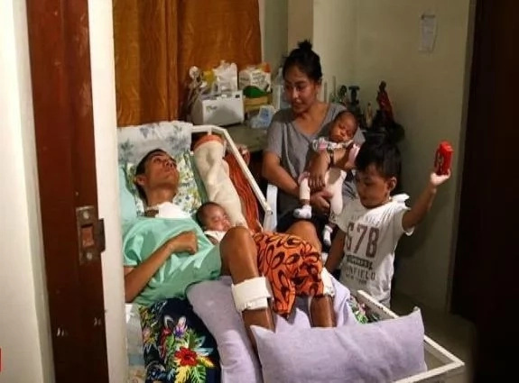 Filipino wife stands by husband in coma