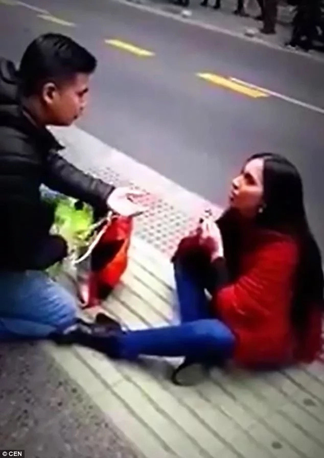 The woman and her boyfriend during her public proposal. Photo: CEN