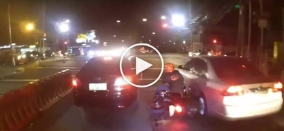Reckless Pinoy motorcycle rider slams into 2 cars after attempting to beat red light