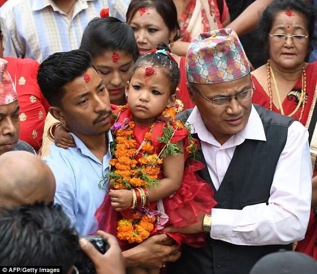 Little Trishna being taken away to the temple. Photo: Getty Images