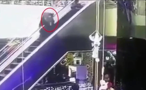 Horrible moment as mom drops her newborn baby 12 METERS to its death at shop (see photos, video)