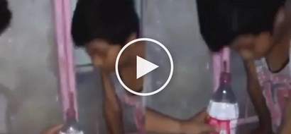 People are instructing a young boy to look into this bottle for unexpected reasons