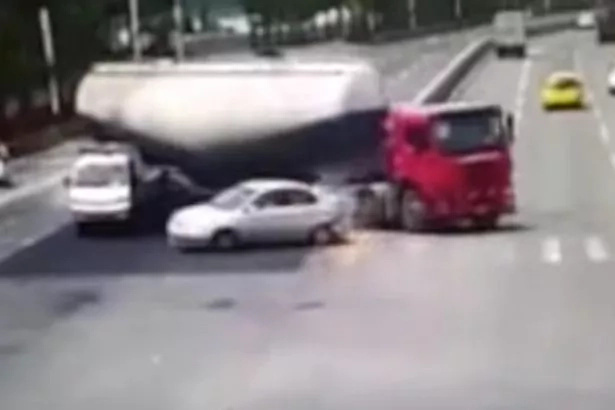 Cement tanker flips on car and crushes it flat (Video)