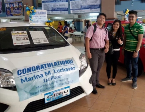 University of Cebu rewards its top board placer with brand new car