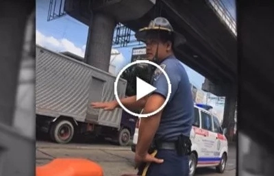 Walang respeto! Cop caught on dash camera slapping motorist on EDSA