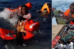 Heartbreaking! Photographer shares pictures of alive and DEAD migrants being pulled out of sea (photos)