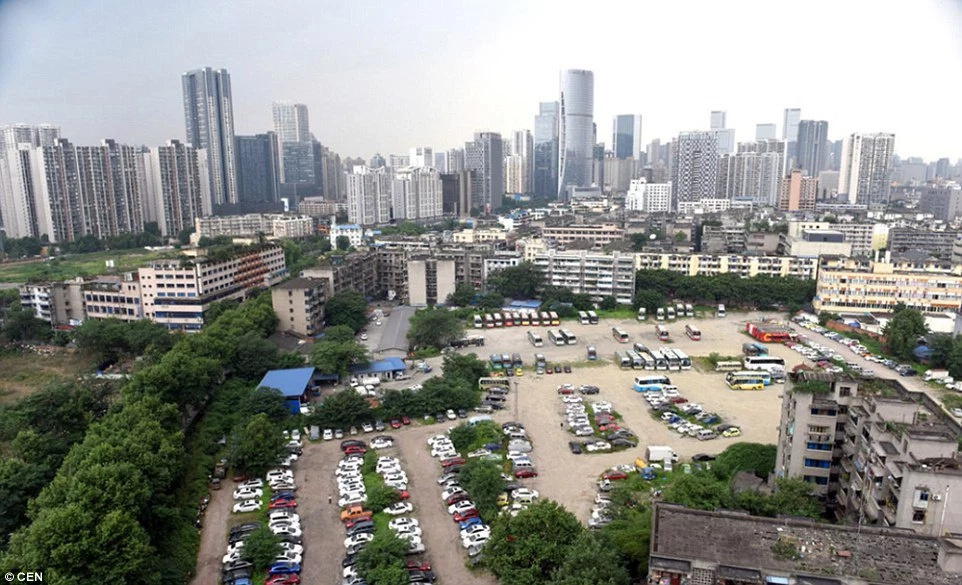 Luxury cars being dumped in a car park in China