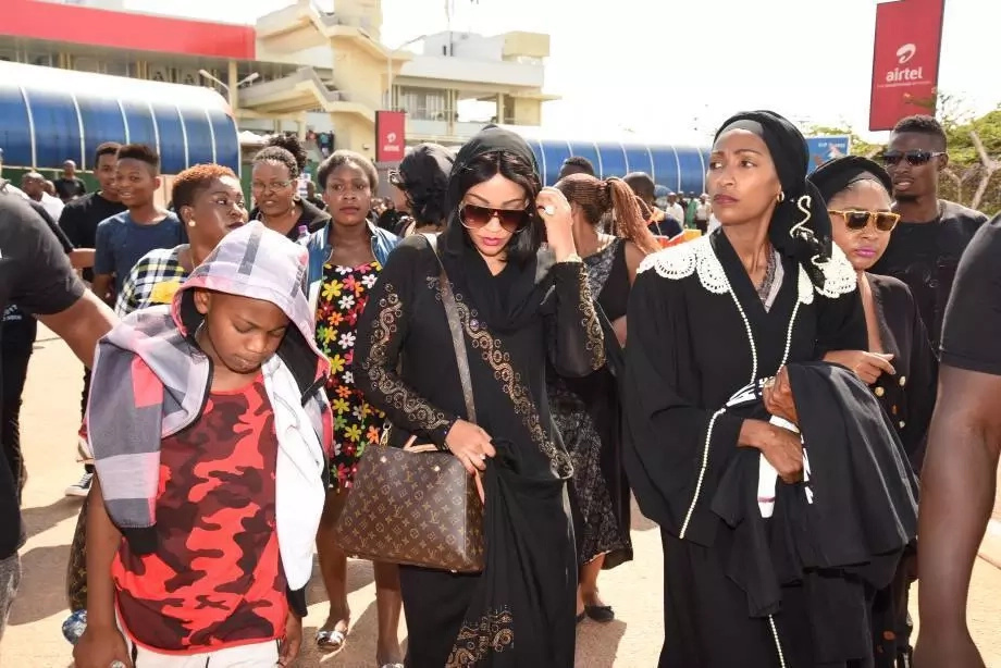 Grief and agony as Zari and her 3 sons fly into Uganda with body of her ex-husband (photos)