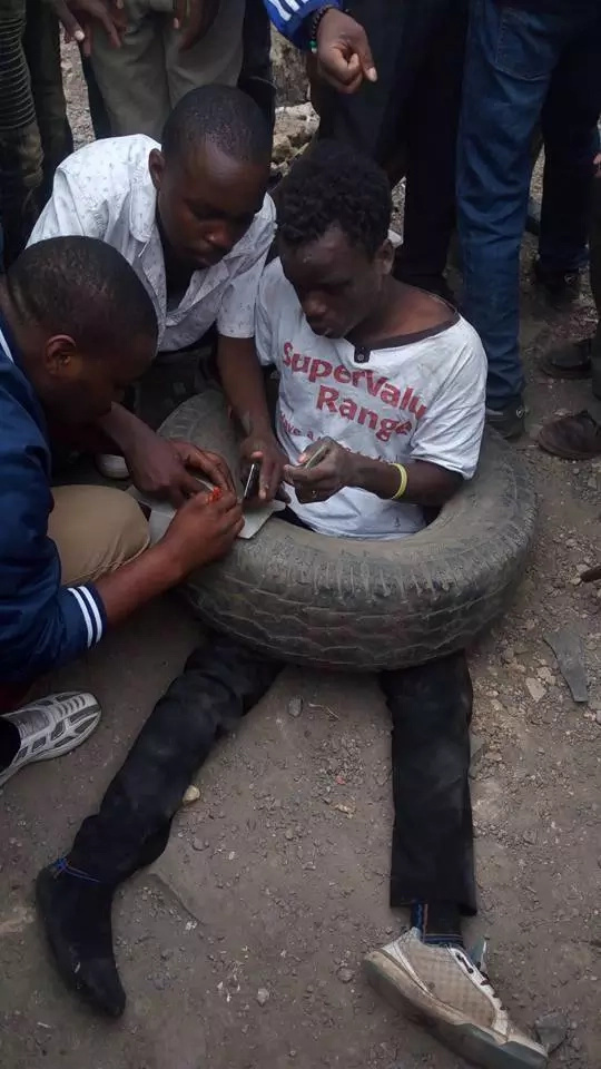 M-Pesa robber nubbed by Donholm residents, police save him