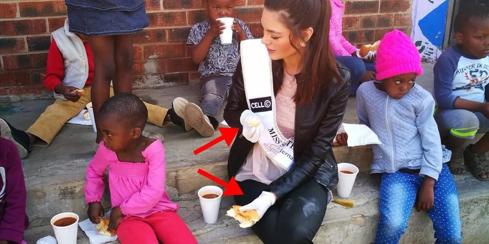 Beauty queen roasted for feeding black kids while wearing gloves