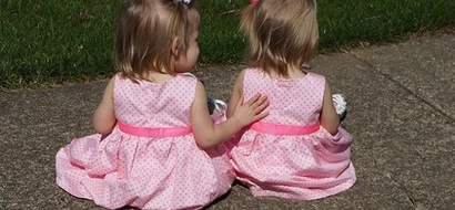 These twins were born holding hands. This is them 2 years later!