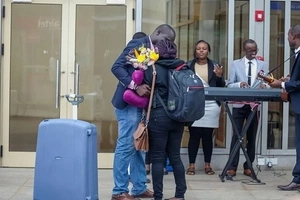 Man causes a MAJOR scene at the JKIA after he went to meet his girlfriend from abroad (photos)