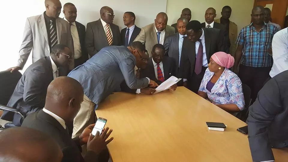 Raila and Kalonzo march to DCI headquarters following the arrest of CORD leaders