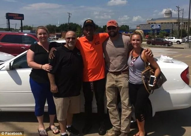 Justin Korva (centre) with some of the community members who gifted him the car