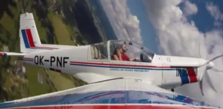 Girl Flies Topless in Stunt Plane to Test the Gravity on Her Breasts