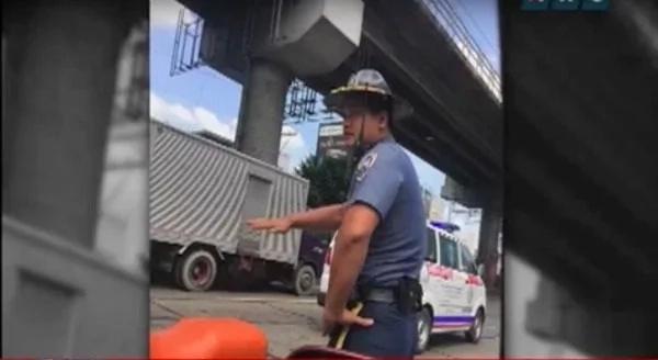 Cop caught on cam slapping motorist