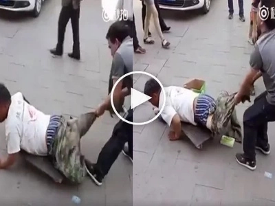Passersby were shocked of a man pulling off a crippled man's trouser! but what happened next surprised them more!